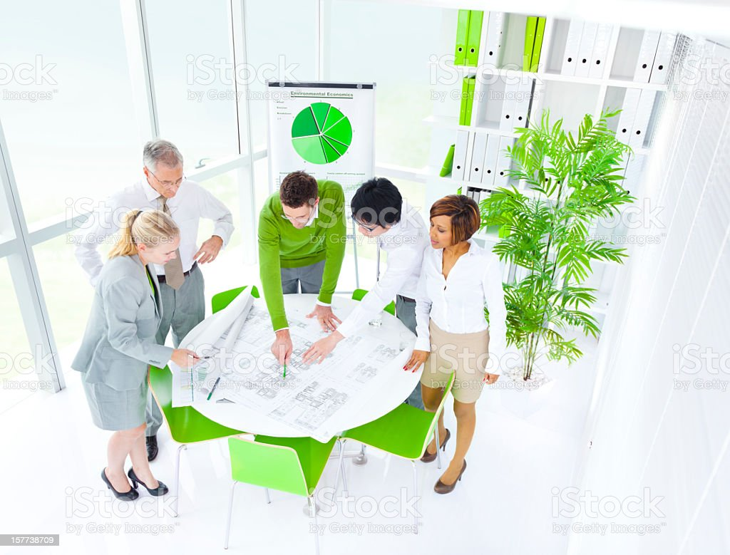 A business meeting with green chairs, charts and plants royalty-free stock photo
