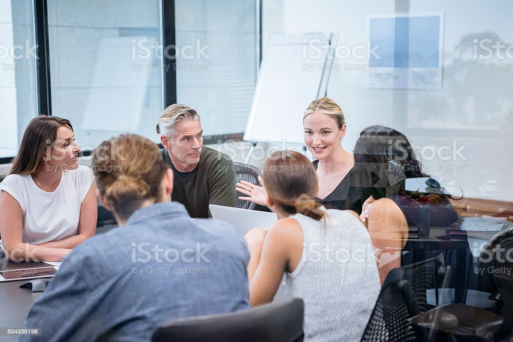 Business meeting with group of multiethnic colleagues stock photo