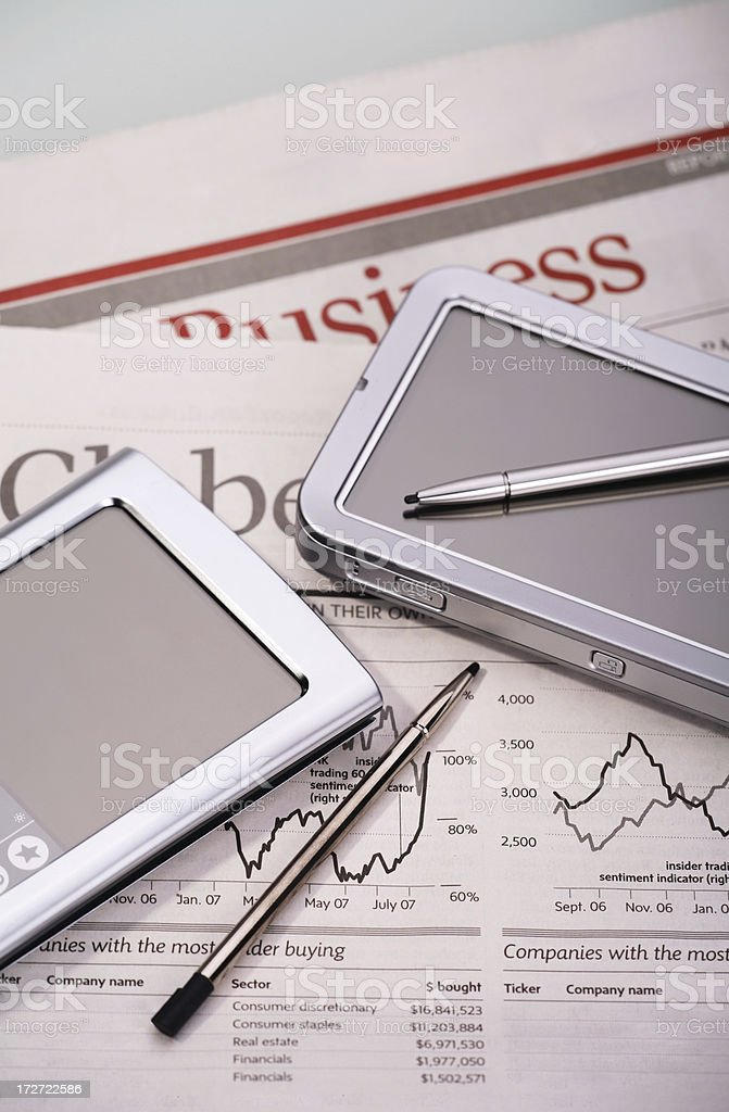 Business meeting with PDA and newspaper royalty-free stock photo