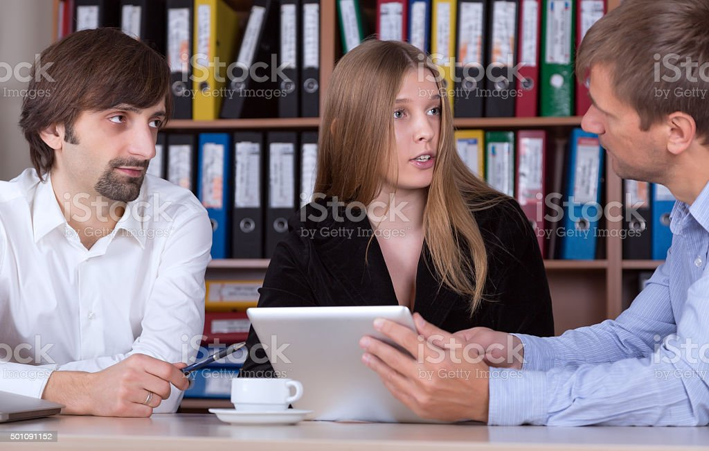 Business Meeting with Tablet presentation and Discussion stock photo
