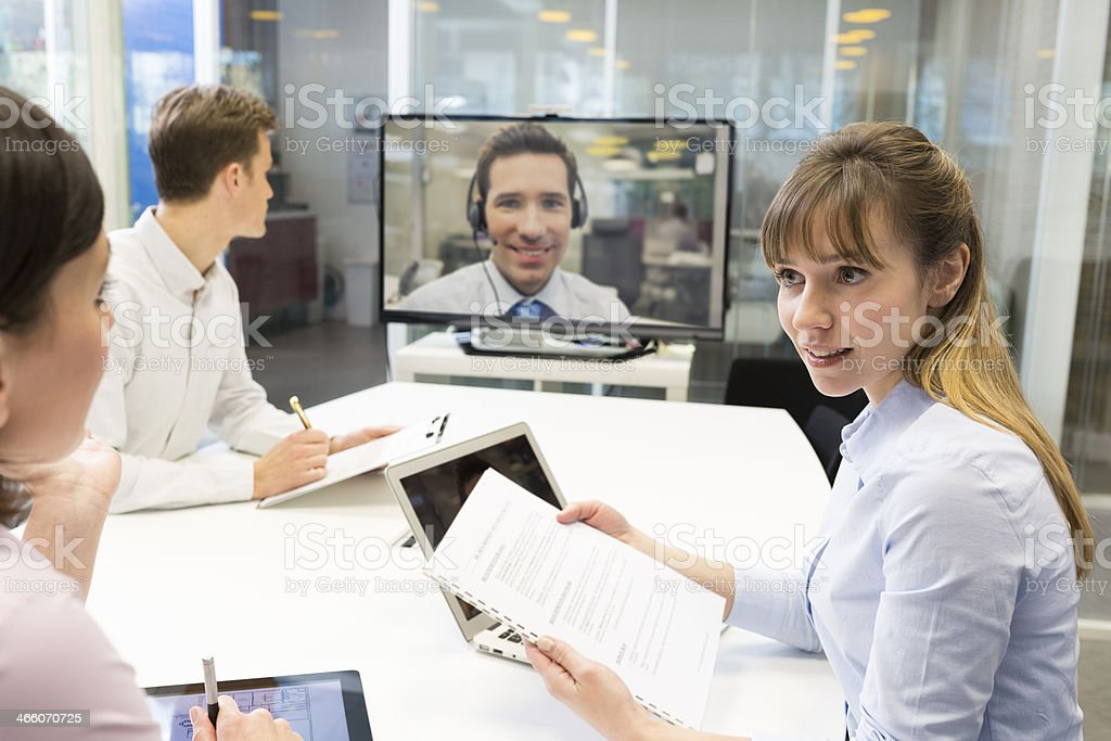 Business meeting in office, chatting on video conference stock photo