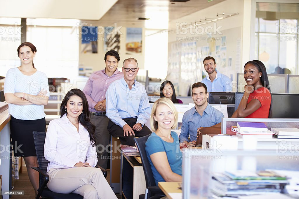Business men and women in open office stock photo