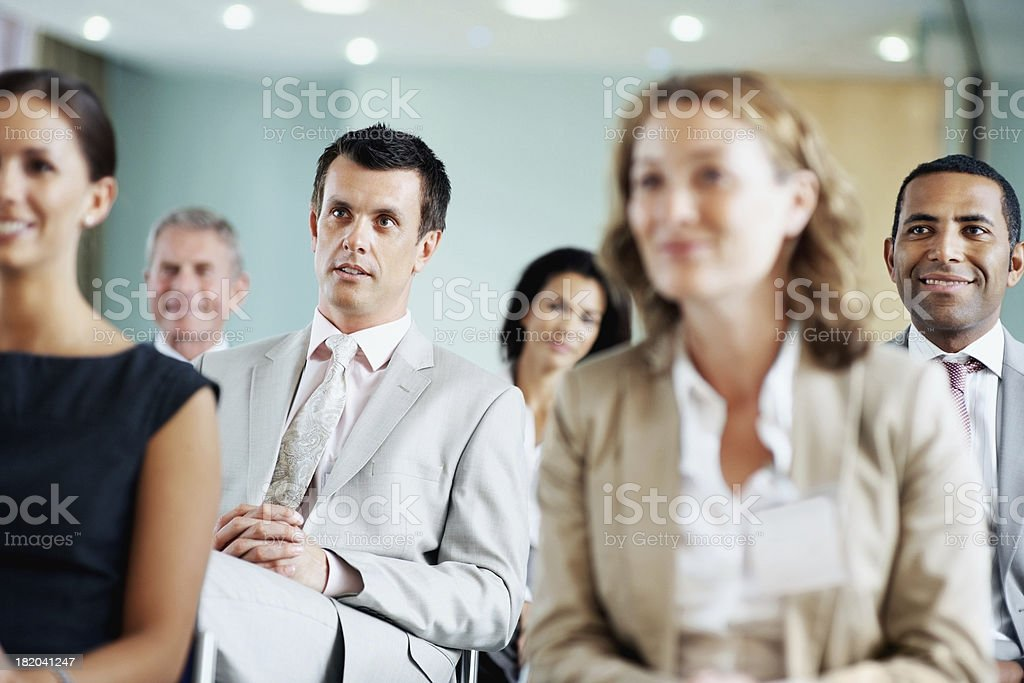 Business men and women sitting for a meeting at seminar royalty-free stock photo