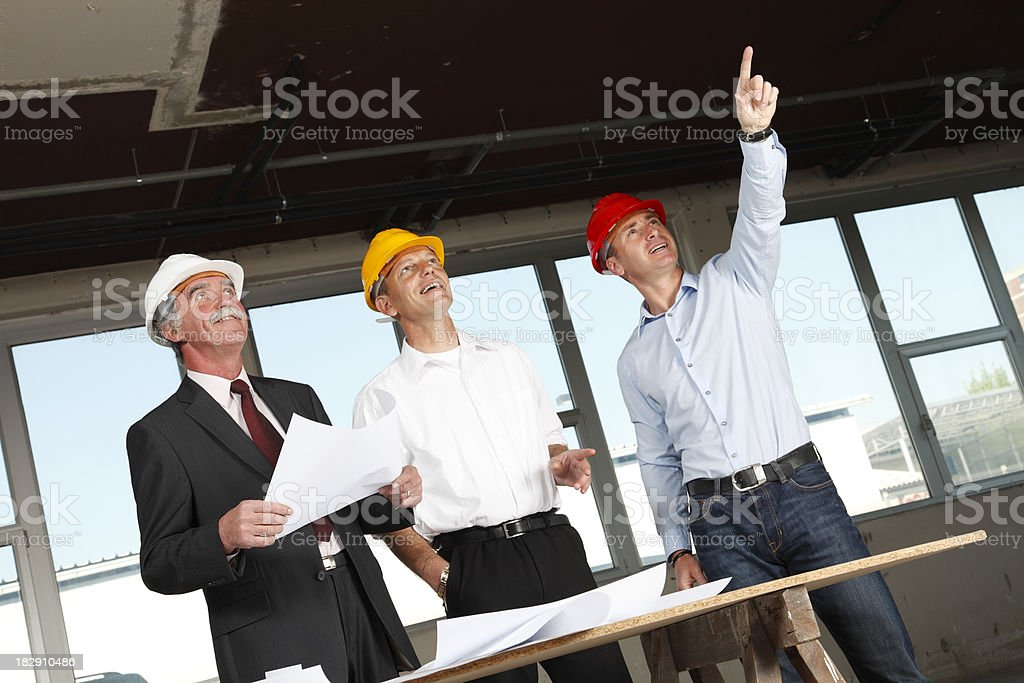 Business men at construction site royalty-free stock photo