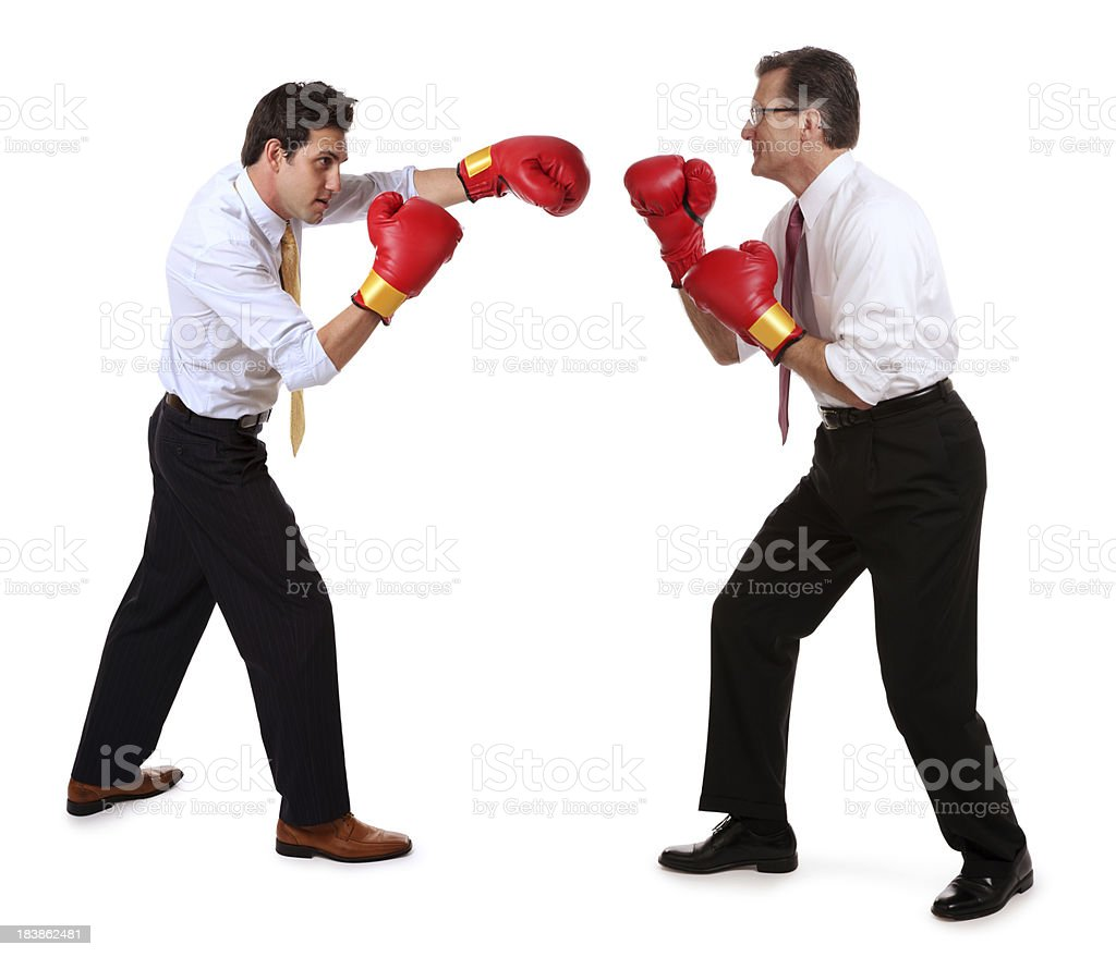Business Men Boxing Each Other stock photo