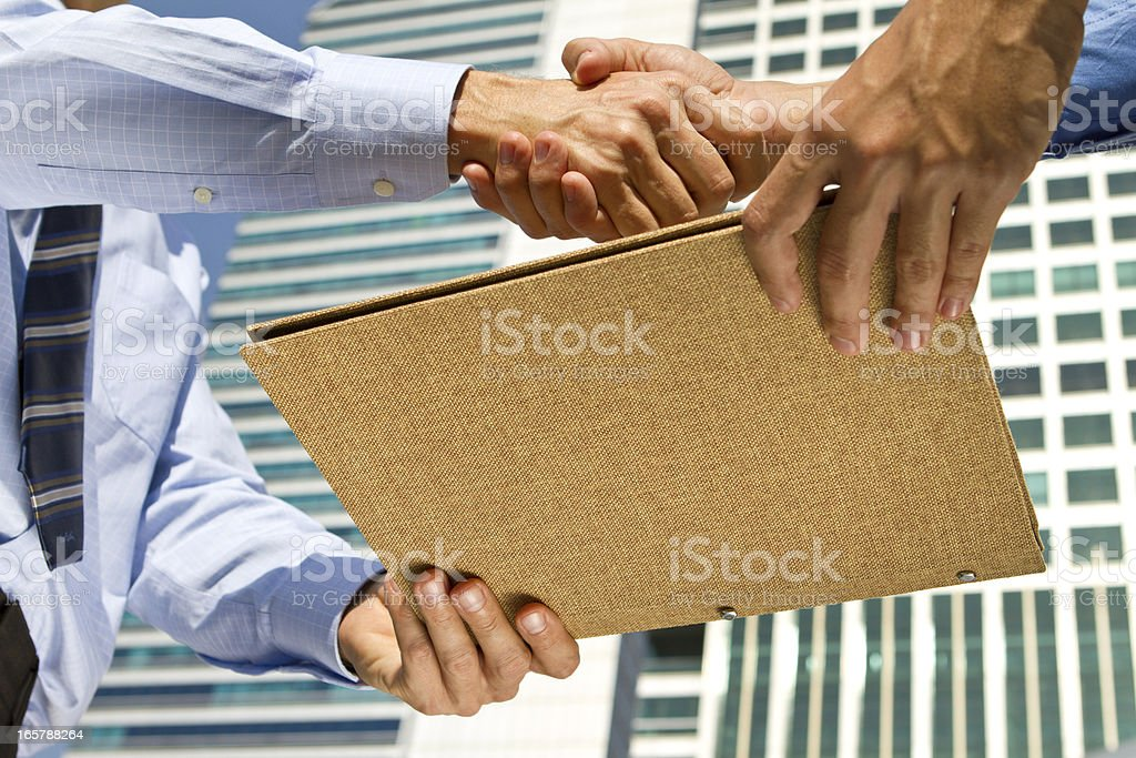 Business men handshaking for the deal in a financial district stock photo