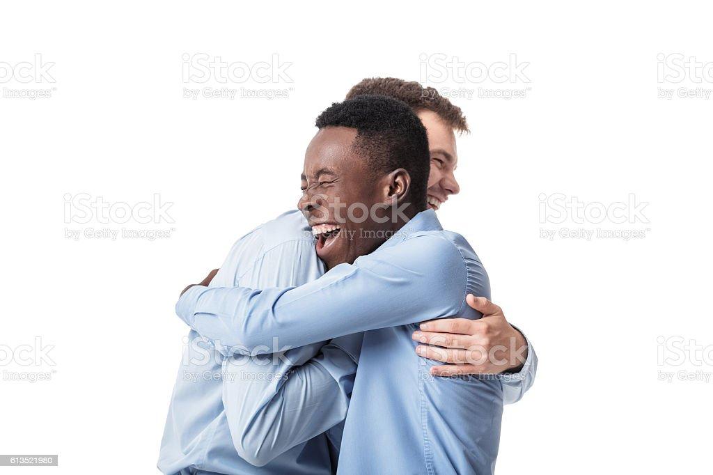 business men happy embracing stock photo
