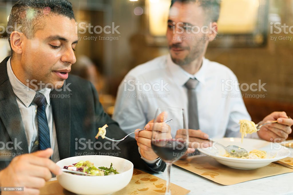 Business Men Having Lunch Restaurant Concept stock photo