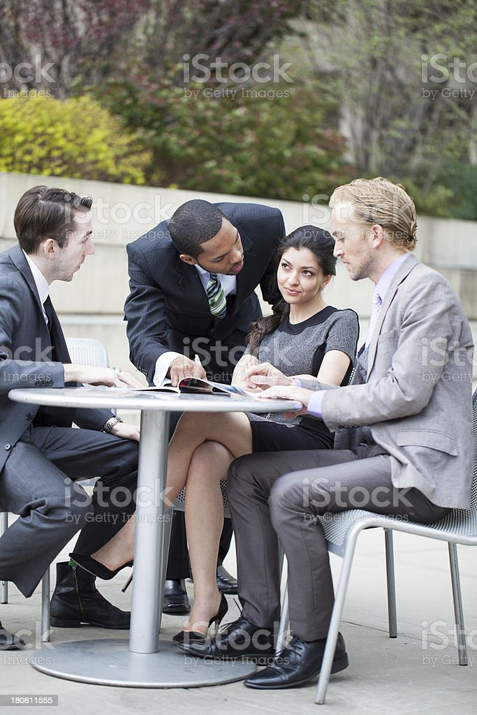 Business men pressuring businesswoman outdoors royalty-free stock photo