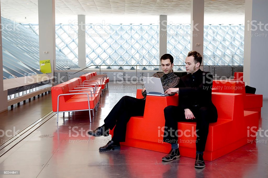 Business Men - Red Chair 1 royalty-free stock photo