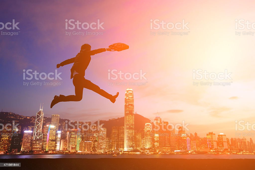 business men run and jump stock photo