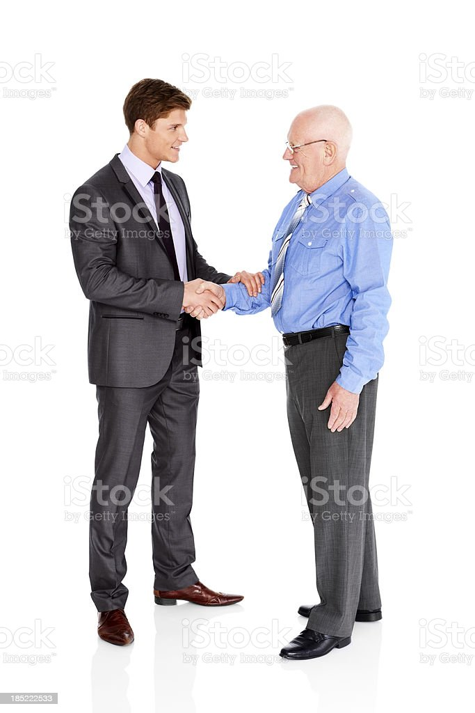 Business men shaking hands on a deal royalty-free stock photo