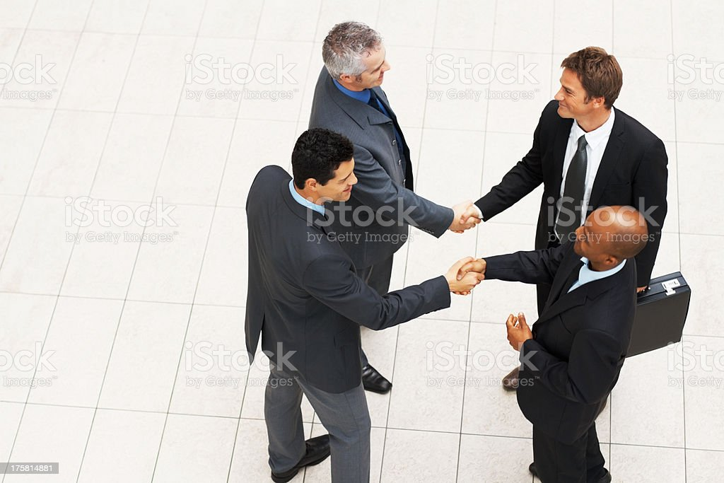 Business men shaking hands to say hello stock photo