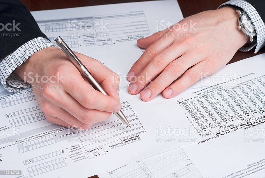 Business men signing documents on a desk. stock photo
