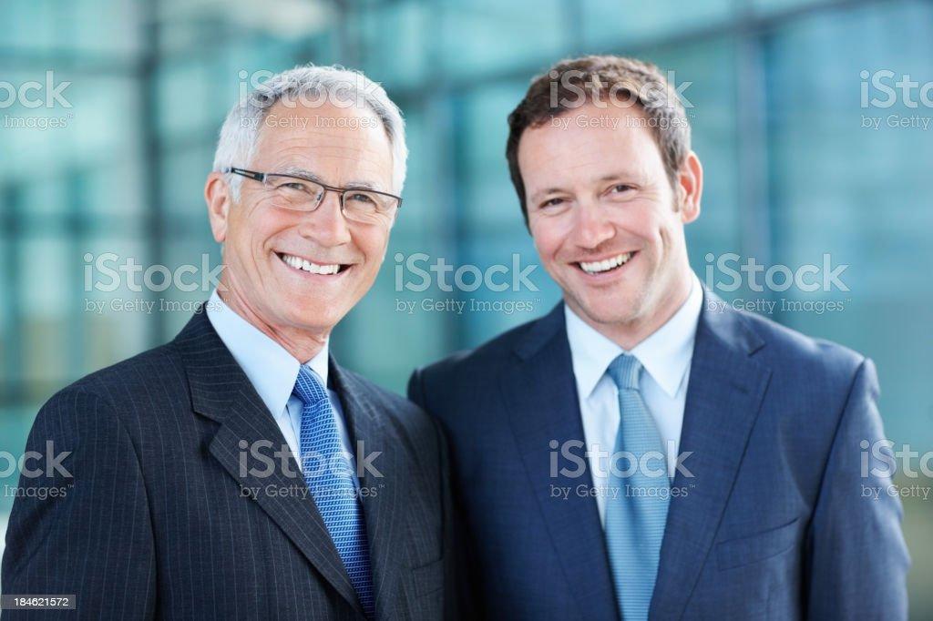 Business men smiling stock photo