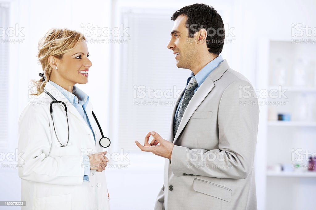 Business men talking with female doctor royalty-free stock photo