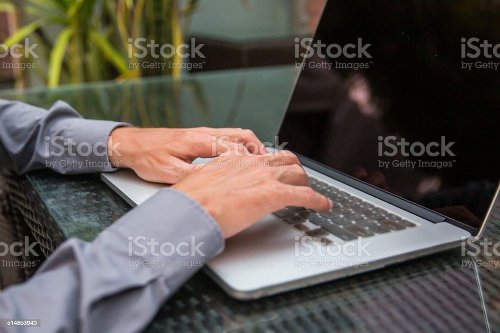Business men typing on laptop stock photo