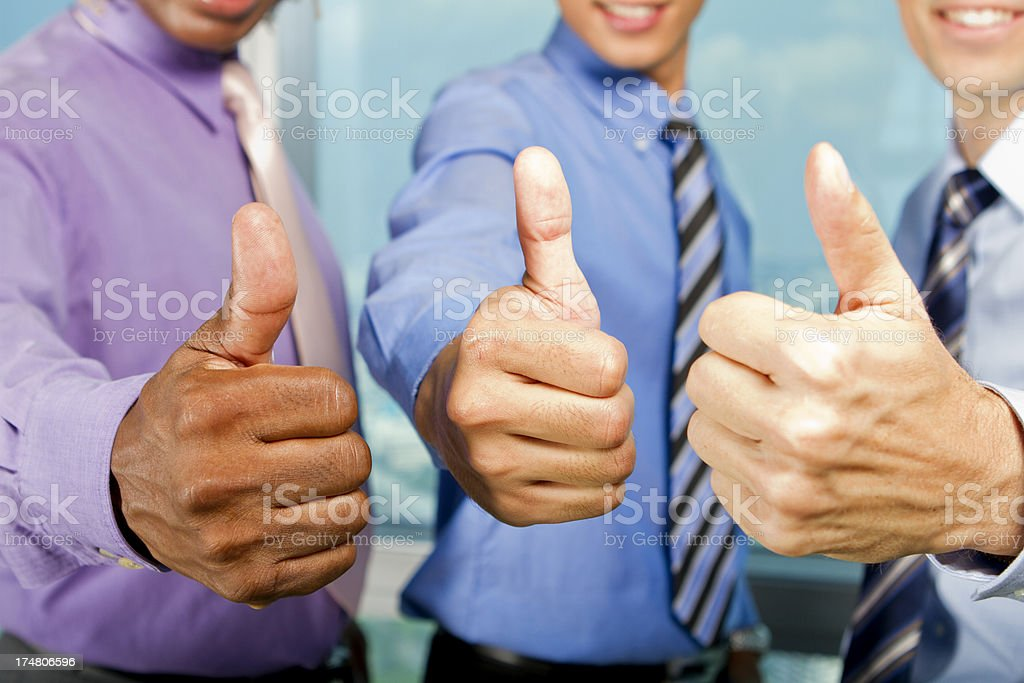 Business men with thumbs up royalty-free stock photo