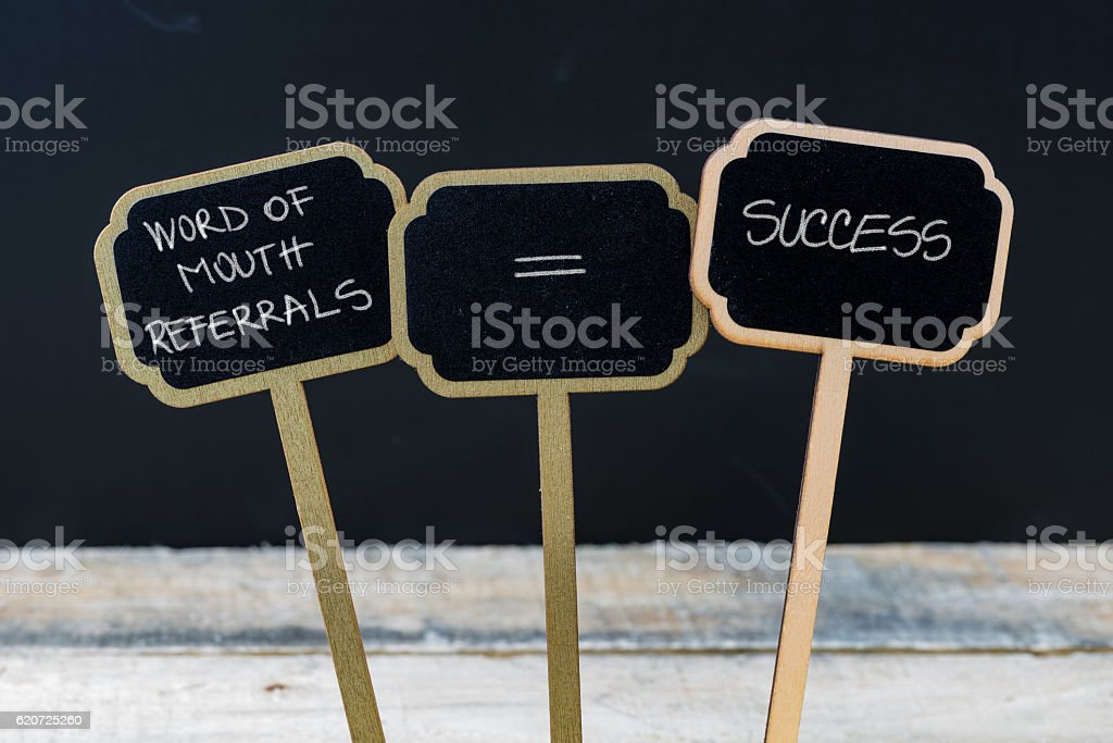 Business message WORD OF MOUTH REFERRALS EQUALS SUCCESS stock photo