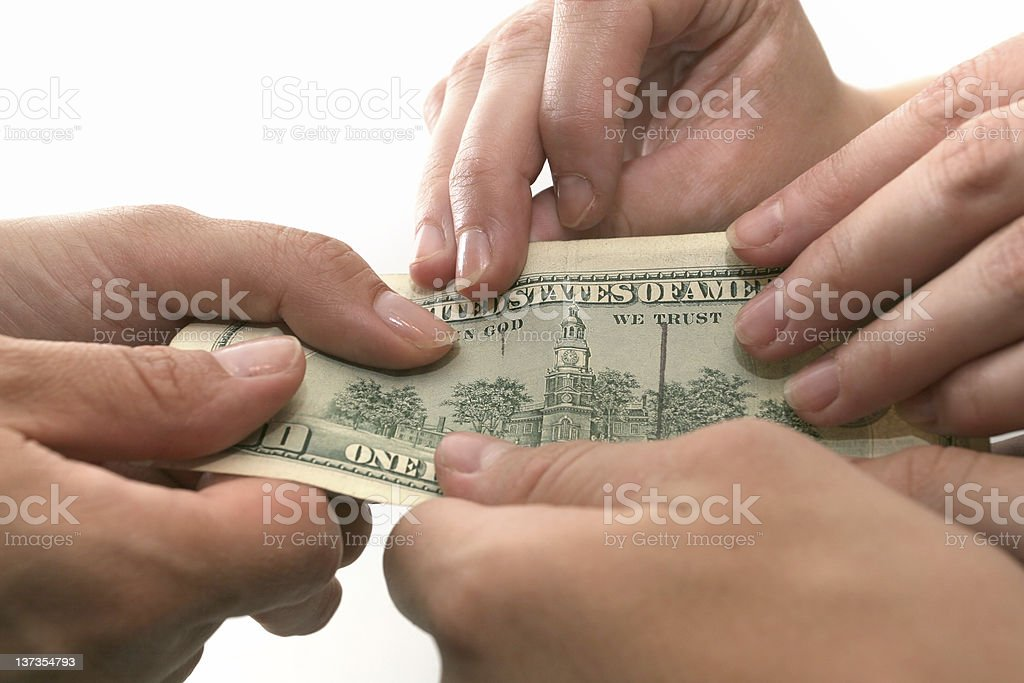 Business - money changing hands stock photo