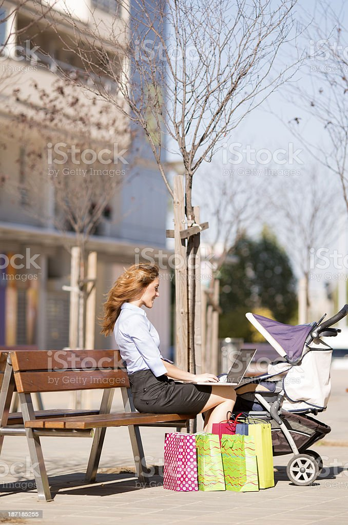 Business mother with strollers working outdoors. royalty-free stock photo