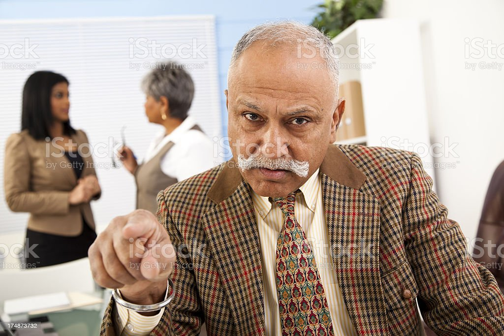 Business: Multi-ethnic coworkers, senior man foreground pointing royalty-free stock photo