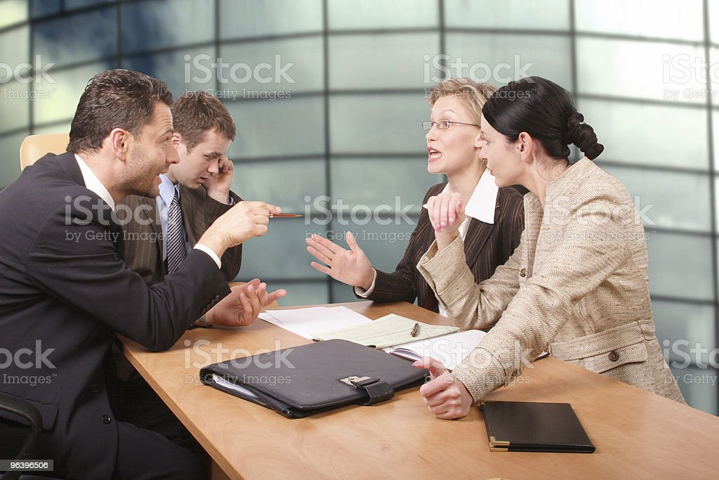 Business negotiations - two men 2 women stock photo