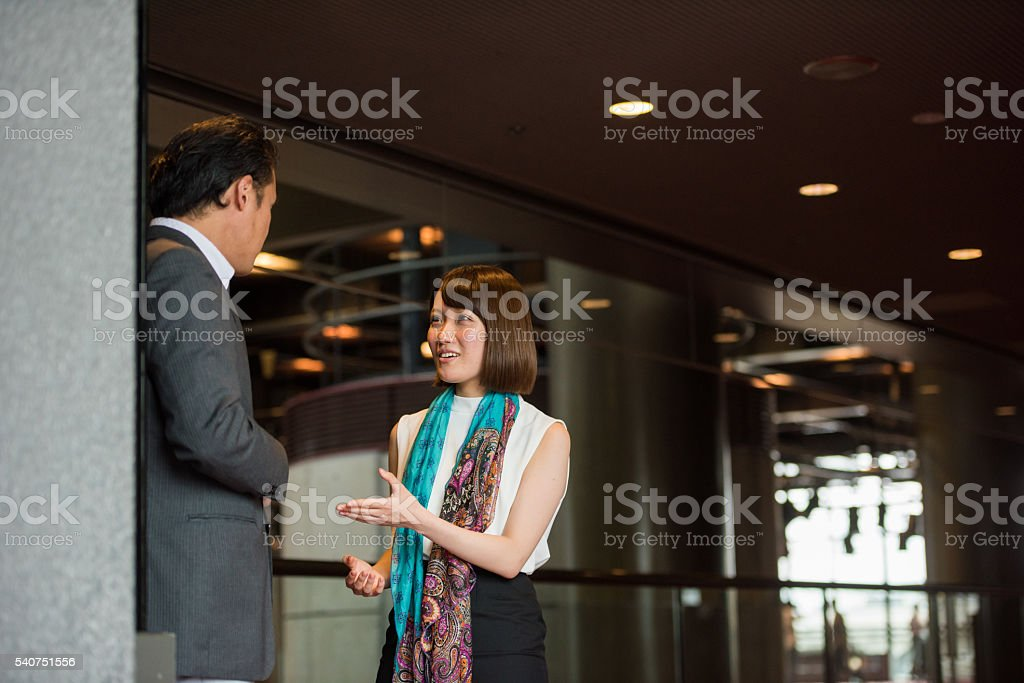 Business networking in a corporate office building foyer