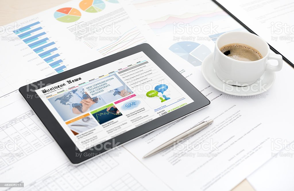 Business news website on digital tablet stock photo
