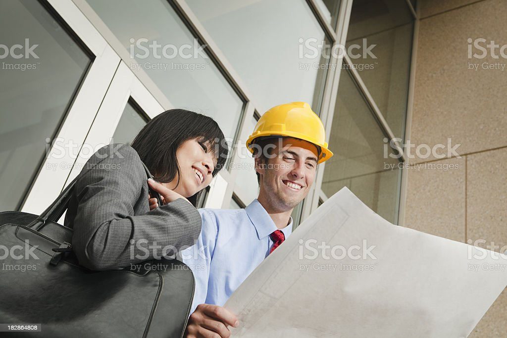 Business of Architect, Contractor, Client Working with Construction Blue Print royalty-free stock photo