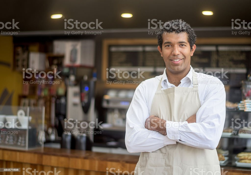 Business owner at a small cafe stock photo