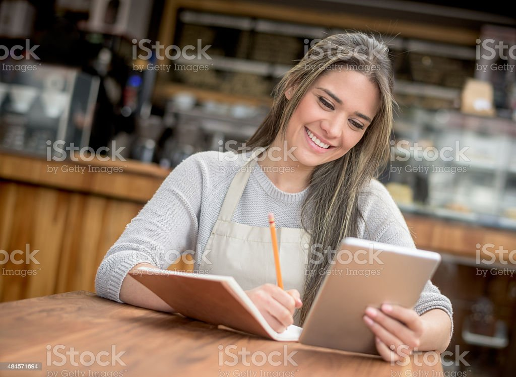 Business owner doing the books at a cafe stock photo