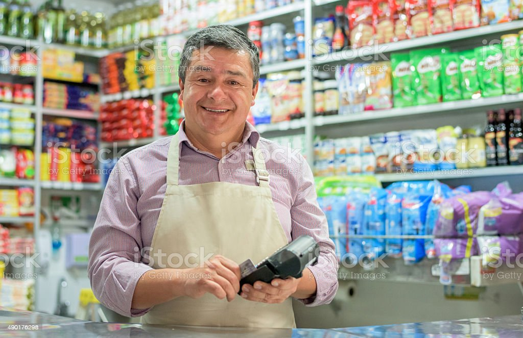 Image result for convenience store owner stock photo