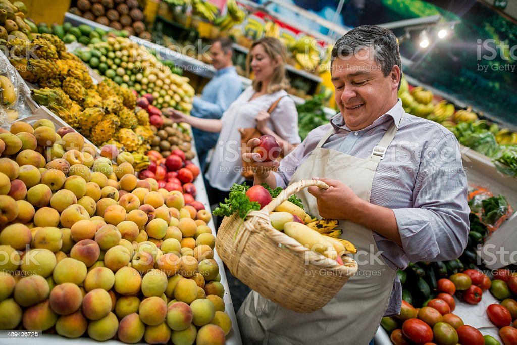 Business owner working at the food market stock photo