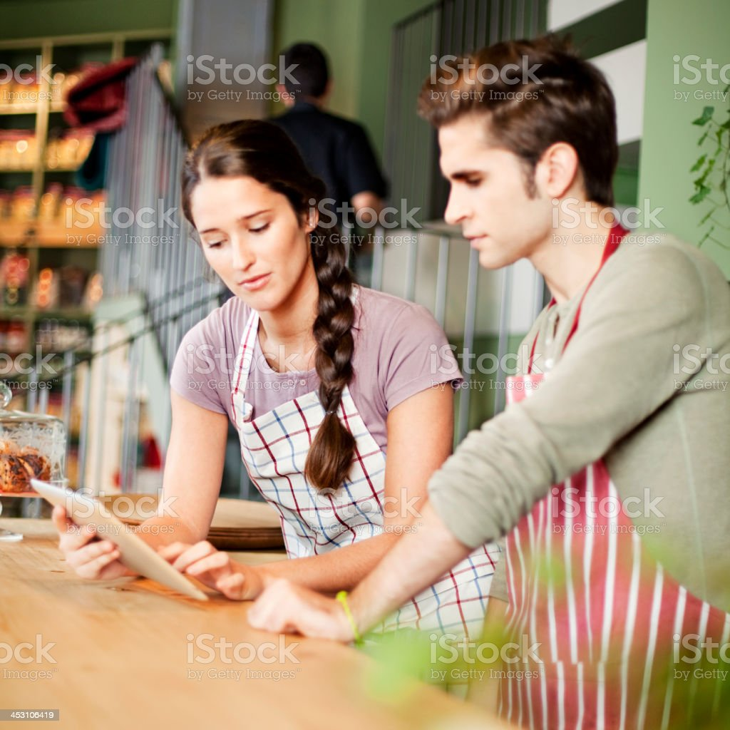 Business owners calculating royalty-free stock photo