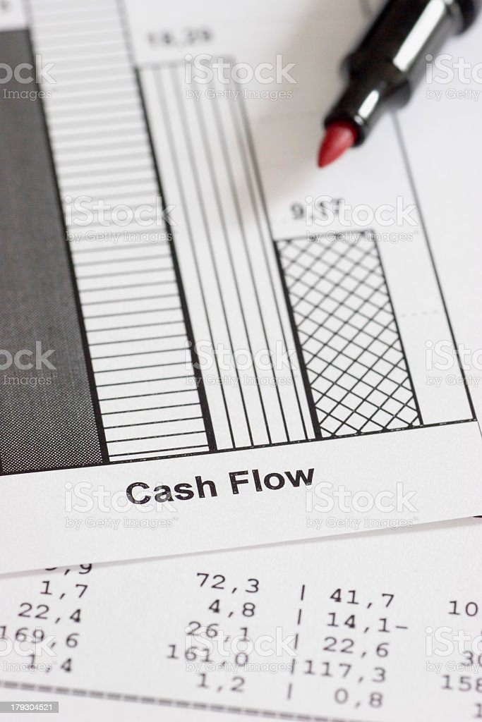 Business papers being worked on in red pencil stock photo