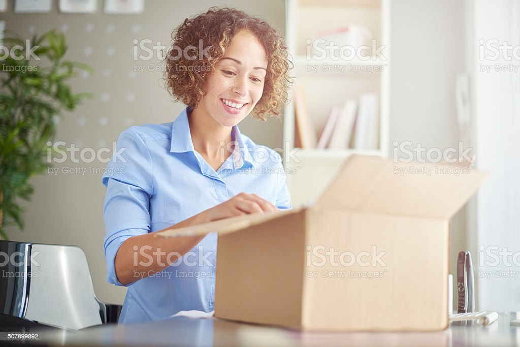 business parcel unpacking stock photo