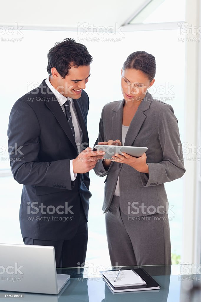 Business partner looking at tablet together royalty-free stock photo