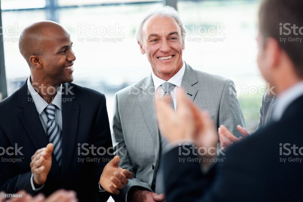 Business partners applauding to their senior leader royalty-free stock photo