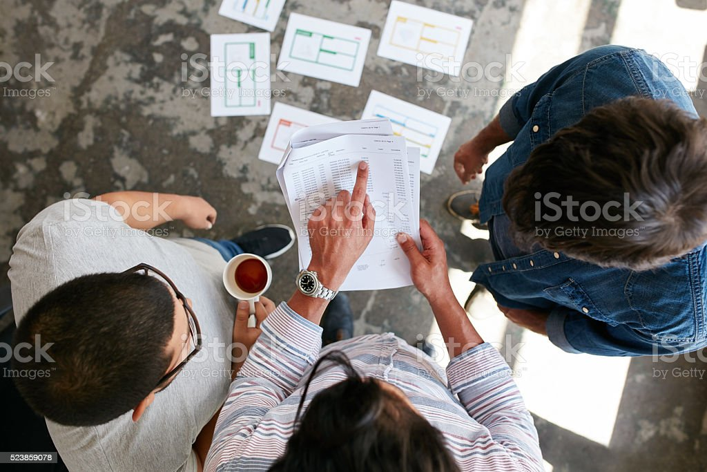 Business partners discussing financial data at meeting stock photo