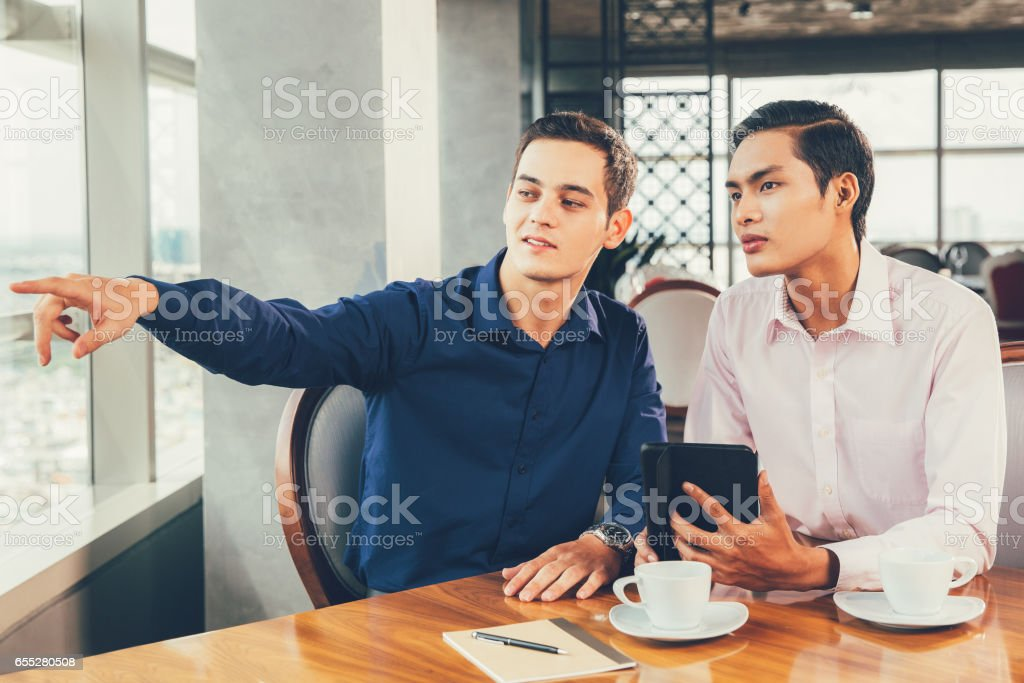 Business Partners Discussing Project in Restaurant stock photo