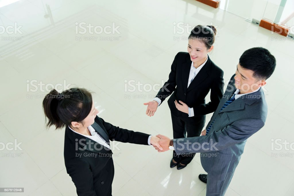 Business partners greeting each other stock photo