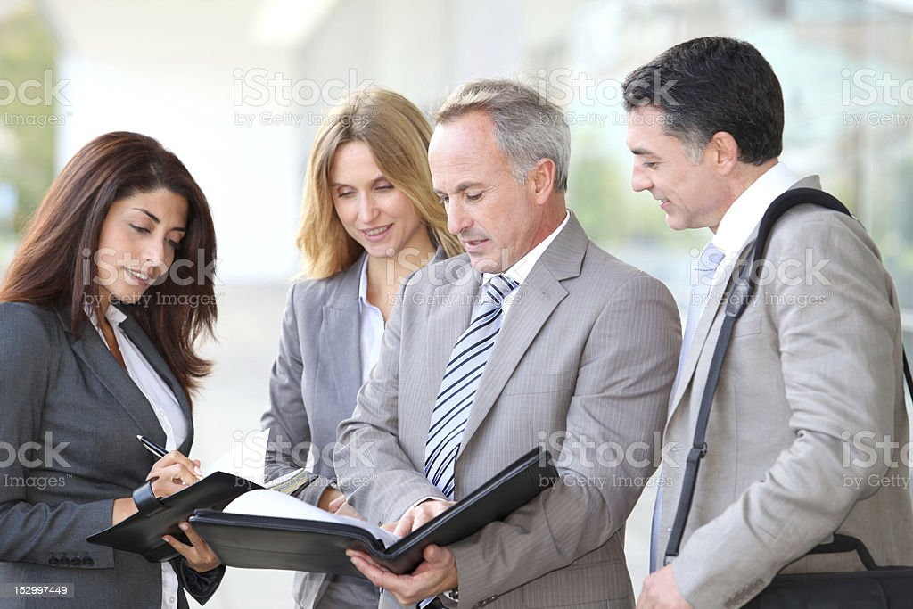 Business partners negotiating contract royalty-free stock photo