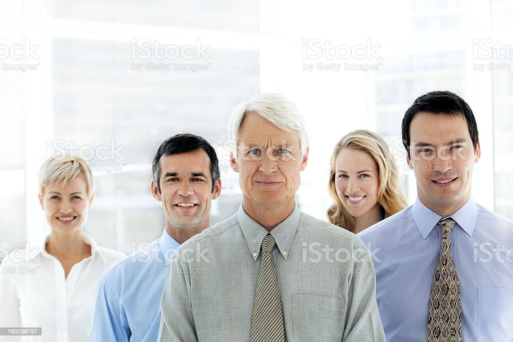 Business partners standing in a row royalty-free stock photo