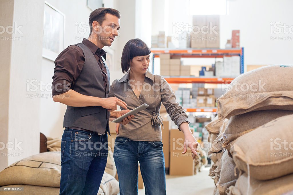 Business partners working at coffee roasting factory stock photo