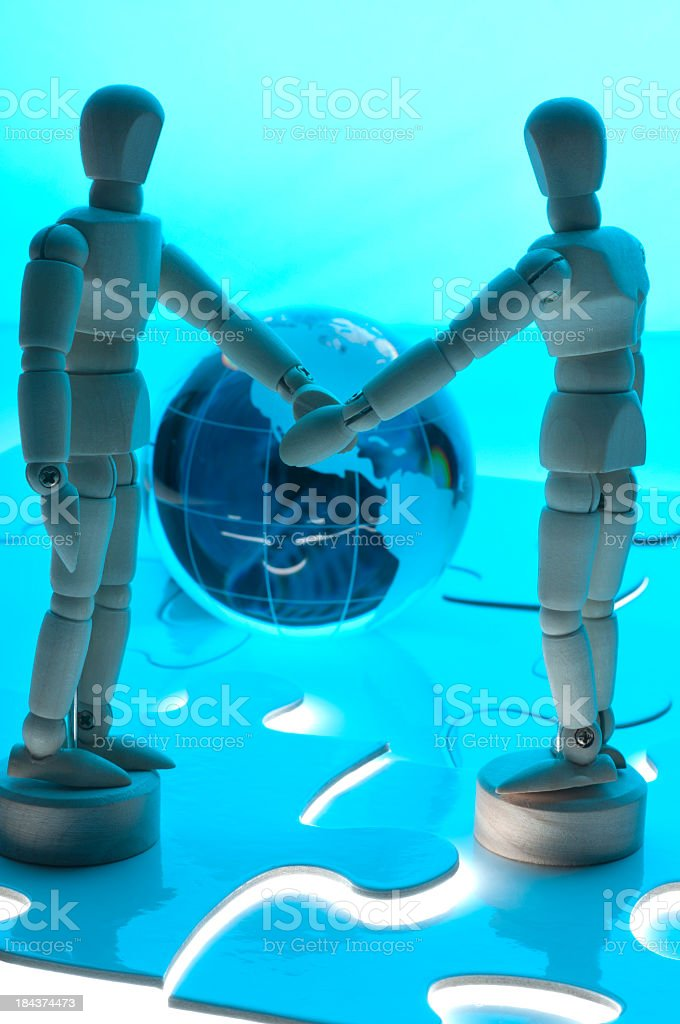 Business partnership concept with 2 wooden figures royalty-free stock photo