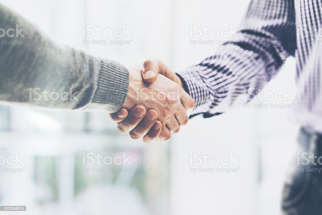 Business partnership meeting concept. Image businessmans handshake. Successful businessmen handshaking stock photo