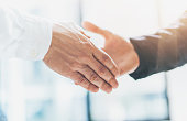 Business partnership meeting. Photo businessmans handshake. Successful businessmen handshaking after