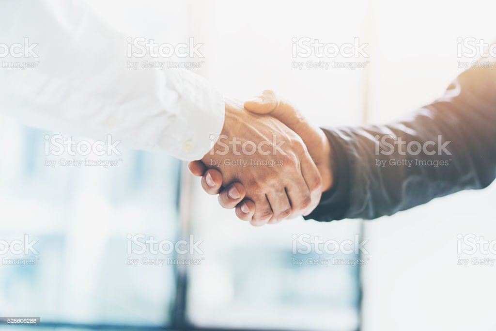 Business partnership meeting. Picture businessmans handshake. Successful businessmen handshaking after stock photo