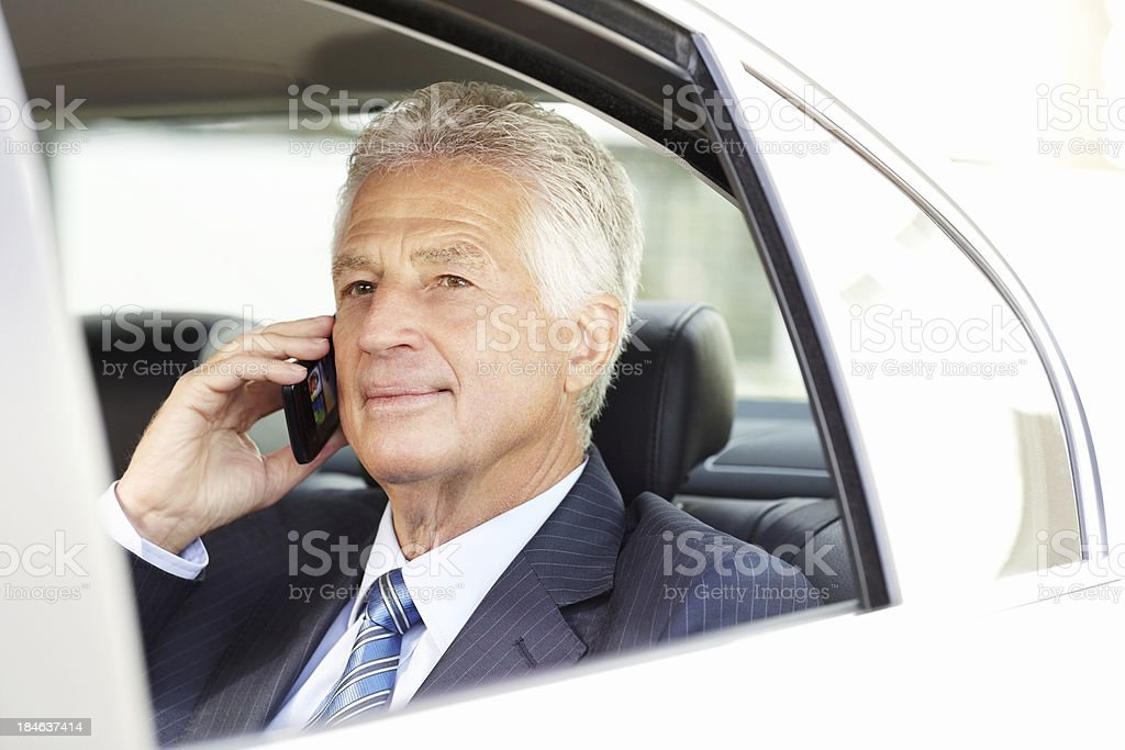Business Passenger on a Cellphone royalty-free stock photo